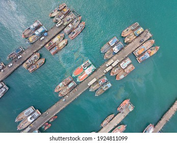 Aerial top view of fisherman dock which has many ships anchoring for transport supplies inland