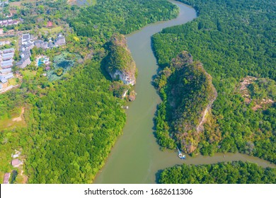 Aerial top view form flying drone of beautiful landscape with mountains, forest beautiful scenery big trees and Palm trees with beginning of sea water. Natural summer landscape of Krabi Thailand.