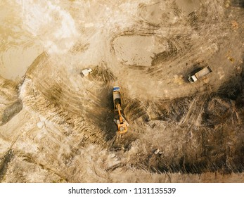 Aerial top view of heavy machinery on construction site.