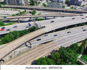 Aerial top view highway I45 (Gulf Freeway), asphalt elevated road and Bayou River in downtown Houston, Texas, US. Passenger cars and trucks are commuting at daytime. Urban transportation publication.