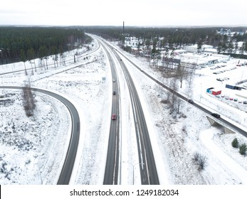 Aerial top view of highway with low traffic on snowy winter day