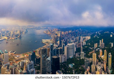 Aerial top view of Hong Kong Downtown, republic of china. Financial district and business centers in smart urban city in Asia. Skyscrapers and high-rise modern buildings at sunset.