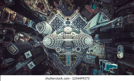 Aerial top view of the iconic or Petronas Towers, also known as the Petronas Twin Towers are twin skyscrapers in Kuala Lumpur. Kuala Lumpur, Malaysia - December 07, 2018.
