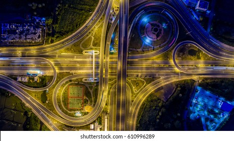 Aerial top view interchange of a city at night, Expressway is an important infrastructure in city.