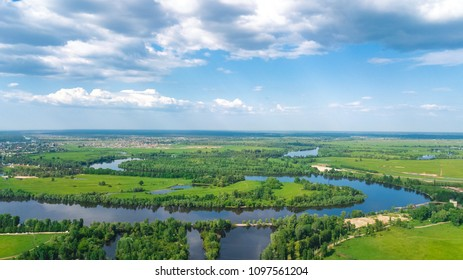 Aerial top view of Kyiv cityscape, Dnieper and Dniester river, green island from above, Kiev city skyline and nature parks in spring, Ukraine