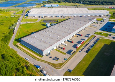 Aerial top view of the large logistics park with warehouse, loading hub with many semi-trailers trucks.