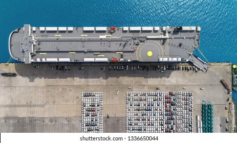Aerial top view Large RoRo (Roll on/off) Car or Vehicle carrier vessel loading car for shipping to worldwide.