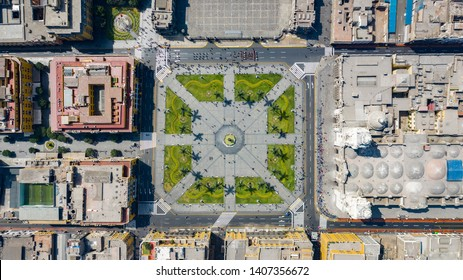 """Aerial top view of Lima main square, government palace of Peru and cathedral church. Bird eye view of tourists and people gathered at """"Plaza de Armas"""" in the historic center capital of Peru."""