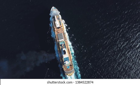 Aerial top view of luxury large cruise ship sailing full speed on open water, luxury vacation concept. Stock. Large Cruise ship sailing across The Mediterranean sea.