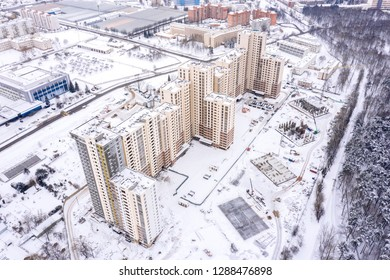 aerial top view of new city residential area under construction, buildings in winter