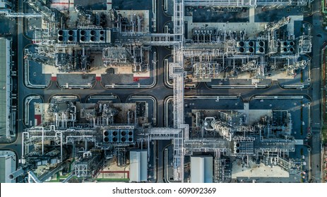 Aerial top view oil and gas refinery background, Business petrochemical industrial, Refinery oil and gas factory power and fuel energy,  Ecosystem and healthy environment concepts.