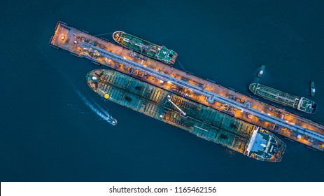 Aerial top view oil tanker ship loading in port view from above, Tanker ship logistic import export business and transportation.
