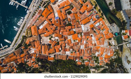 Aerial top view of old town Kotor and Boka Kotorska bay on the Adriatic sea in summer. Bay of Kotor is one of the most popular places on Adriatic Sea.