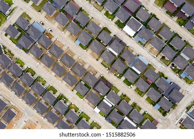 Aerial top view over modern suburb housing estate project neighborhood, Thailand. Housing construction business.