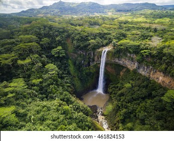 Aerial top view perspective of Chamarel Waterfall in the tropical island jungle of Mauritius