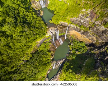 Aerial top view perspective of Tamarin Waterfall Seven Cascades in the tropical island jungle of Mauritius
