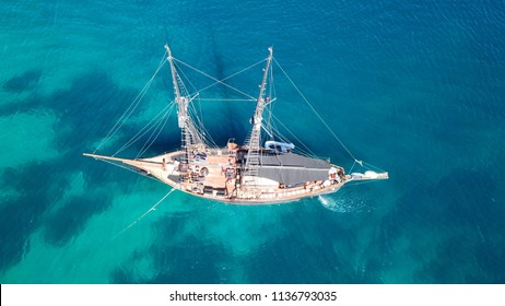 Aerial top view photo of classical retro sail boat docked in tropical bay