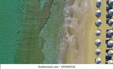 Aerial top view photo of famous emerald seascape at Kionia, Tinos island, Cyclades