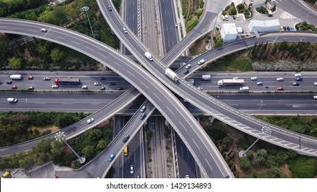 Aerial top view photo of highway multilevel junction road in urban populated area