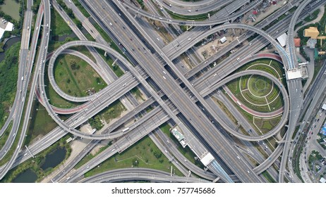 Aerial top view of the ring road, expressway looks like infinity sign with the moving cars