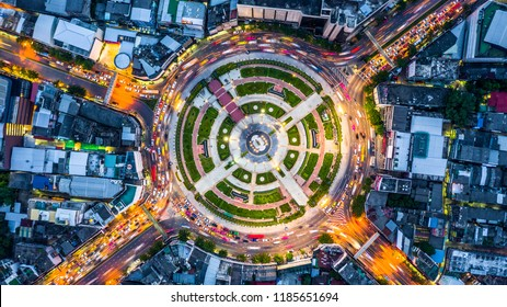 Aerial top view road roundabout with car lots,   Aerial view road traffic in city at night.