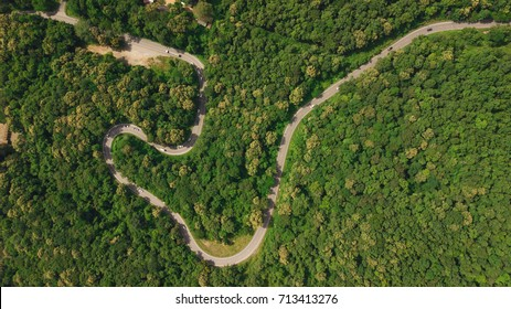 Aerial top view top view of the road through the trees,