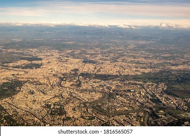 Aerial Top View Of Rome, Italy From Window Of Airplane At Sunset.