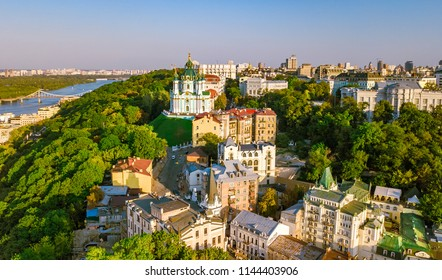 Aerial top view of Saint Andrew's church and Andreevska street from above, cityscape of Podol district on sunset, skyline of city of Kiev (Kyiv), Ukraine