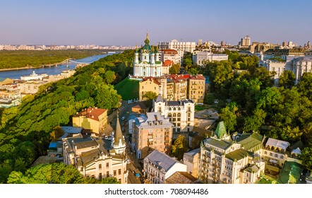 Aerial top view of Saint Andrew's church and Andreevska street from above, cityscape of Podol district on sunset, city of Kiev (Kyiv), Ukraine