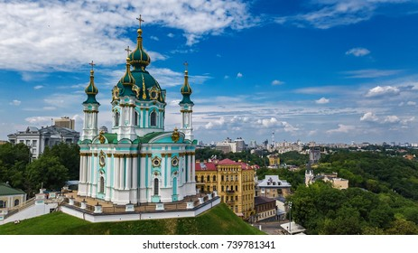 Aerial top view of Saint Andrew's church and Andreevska street from above, cityscape of Podol district, city of Kiev (Kyiv) skyline, Ukraine