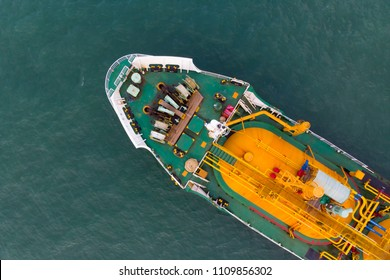 Aerial Top View of sea freight, Crude oil tanker lpg ngv at industrial estate Thailand / Crude Oil tanker to Port of Singapore - import export around in the world
