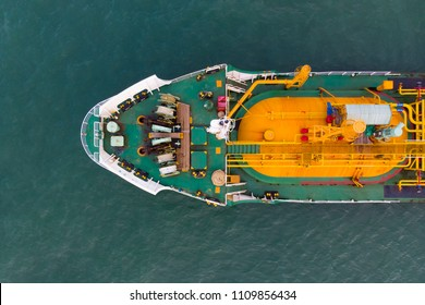 Aerial Top View of sea freight, Crude oil tanker lpg ngv at industrial estate Thailand / oil tanker ship to port of Singapore - import export around in the world