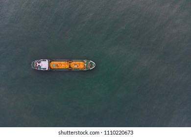 Aerial Top View of sea freight, Crude oil tanker lpg ngv at industrial estate Thailand / Group of Oil tanker ship to Port of Singapore - import export around in the world