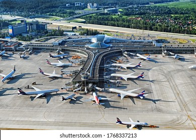 Aerial top view of Sheremetyevo airport terminal D building with aeroflot airbus boeing passenger airplanes grounded due to covid-19 virus worldwide outbreak in Moscow Russia on June 2020
