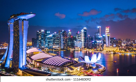 Aerial top view Singapore city skyline, Singapore business building around Marina bay at night.