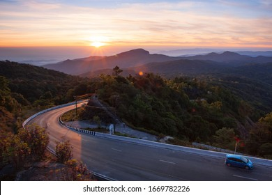 Aerial top view of sky road over top of mountain with green jungle in the morning at Chiangmai Thailand.