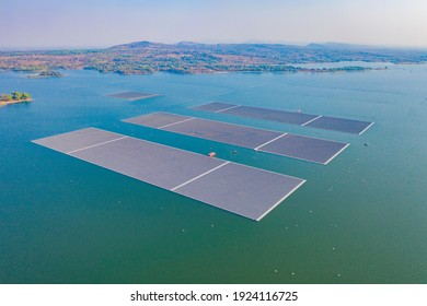Aerial top view of solar panels or solar cells on buoy floating in lake sea or ocean. Power plant with water, renewable energy source. Eco technology for electric power in industry.