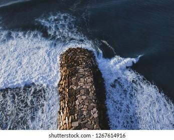 Aerial top view from a stone Jetty. Drone photo