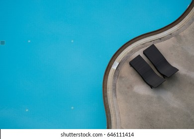 Aerial or top view of swimming pool with bed