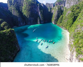 "Aerial top view of turquoise lagoon in heart shape ""Love"" inside of rocky tropical island. It's natural swimming pool at Phi Phi Leh island, Krabi, Thailand"