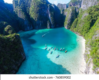 """Aerial top view of turquoise lagoon in heart shape """"Love"""" inside of rocky tropical island. It's natural swimming pool at Phi Phi Leh island, Krabi, Thailand"""