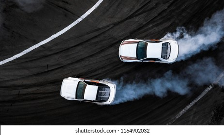 Aerial top view two cars drift battle on race track, Two race cars view from above.