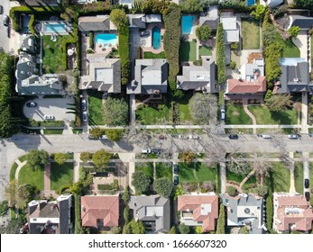Aerial top view of wealthy area with big houses and small street in Central Los Angeles , California. USA
