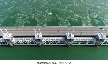 Aerial top-down photo of Oosterscheldekering four pillars the largest of the 13 ambitious Delta Works series of dams designed to protect the Netherlands from flooding from the North Sea