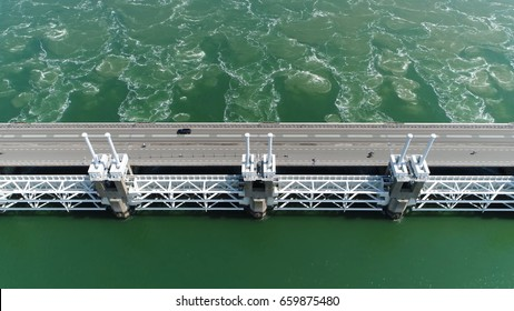 Aerial top-down photo of Oosterscheldekering three pillars the largest of the 13 ambitious Delta Works series of dams designed to protect the Netherlands from flooding from the North Sea