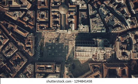 Aerial top-down shot of crowded square and the Cathedral or Duomo in the centre of Milan. Lombardy, Italy