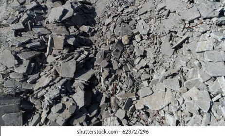 Aerial top-down view of debris also known as rubble wreckage ruins or scattered remains of destroyed building showing concrete parts piled up and not used anymore perfect concrete rubble background