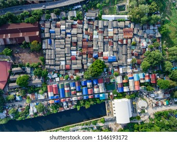 Aerial topdown view of slump area in urban city. With many small houses cluster together. Urban poor income living concept.