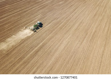 Aerial Tractor sowing crops at field