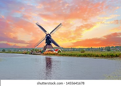 Aerial from a traditional windmill in the countryside at Kinderdijk in the Netherlands at sunset